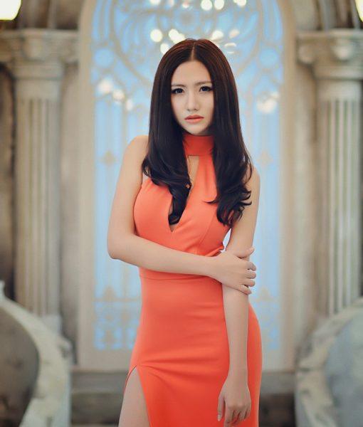 Đầm dạ hội cam cổ lọ khoét ngực xẻ đùi cao sexy - D357