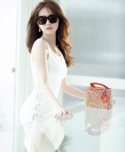 Đầm ôm body xẻ tà bên đan dây trắng giống như Ngọc Trinh - DN277